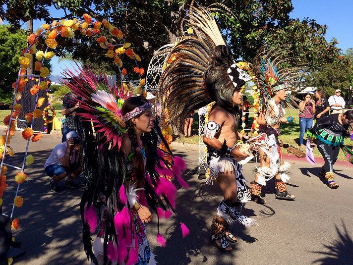 Aztec dance group Ketzaliztli perform during Dia de los Muertos at Woodlawn Cemetery
