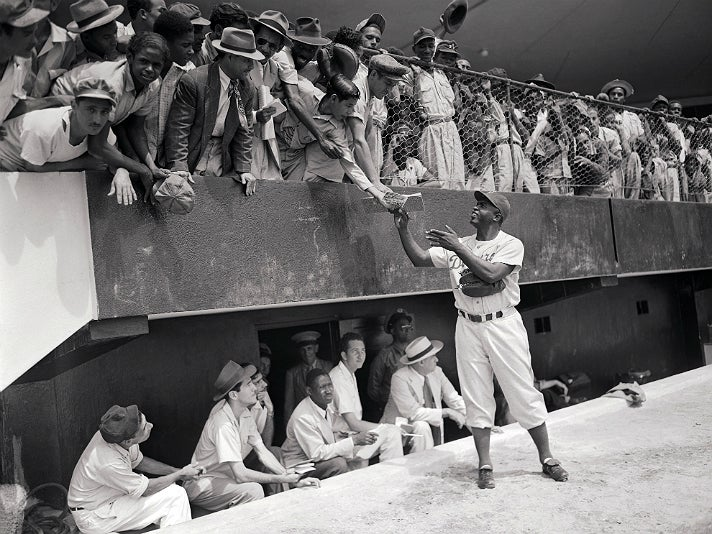 """Photo of Jackie Robinson signing autographs, from """"Chasing Dreams"""" at Skirball Cultural Center"""