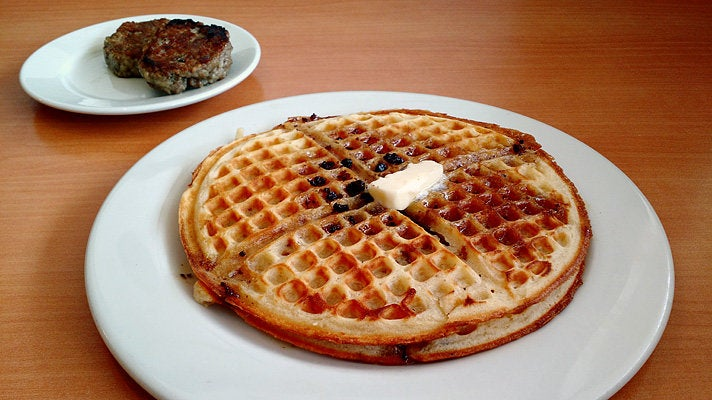 Bacon waffle with house-made sausage patties at The Nest
